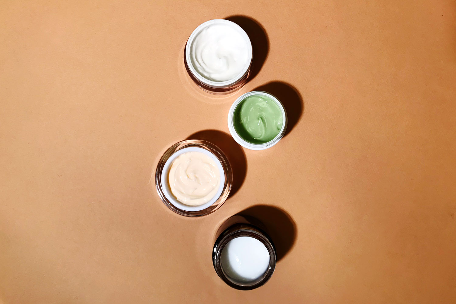 moisturizers with lids open to show texture